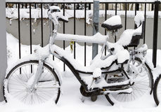 Bicycle with infant seat covered in snow Royalty Free Stock Photo