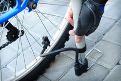 Bicycle. Inflating the tire of a bicycle Royalty Free Stock Photo