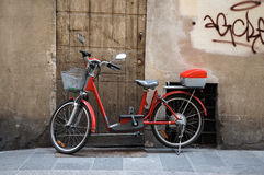 Bicycle on Italian Street. Red bicycle on the sidewalk of a street in Florence, Italy.  Preferred mode of transportation for many Europeans Stock Images