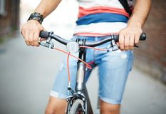 Bicycle and its owner Royalty Free Stock Photography