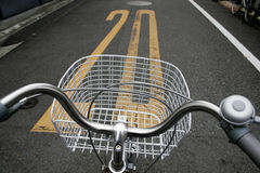 Bicycle on Japanese Street with speed limit Stock Image