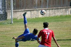 Bicycle kick. A bicycle kick in the deaf world cup football match greece vs iran played at eboli in italy royalty free stock photos