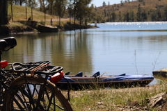 Bicycle in the lake. Partial view of a bicycle in front of a lake Royalty Free Stock Photos