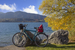 Bicycle at the lake shore tegernsee, beautiful autumn day Royalty Free Stock Image