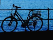 Bicycle lake silhouette Royalty Free Stock Photos