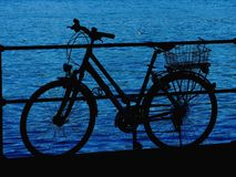 Bicycle lake silhouette Stock Photos