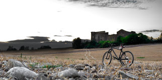 Bicycle landscape. With ruins of an old house Stock Photography