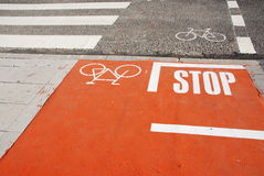 Bicycle lane. Photo of a bicycle lane on a urban road with a pedestrian crossing Stock Photo