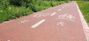 Bicycle lane. Red bicycle lane with bike symbol Royalty Free Stock Photos