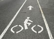 Bicycle lane. Marker on a city street Stock Photos