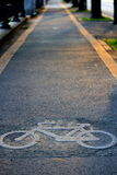 Bicycle lane. A yellow striped bicycle lane Royalty Free Stock Photos