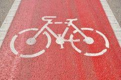 Bicycle Lane. Sign on red asphalt Royalty Free Stock Photo