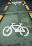 Bicycle lane. Green bicycle lane with white bicycle sign Royalty Free Stock Photos