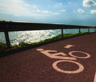 Bicycle lane along the coastal road Royalty Free Stock Photos