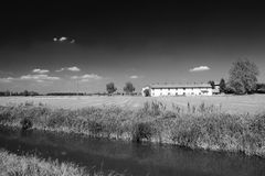 Bicycle lane along the Naviglio of Bereguardo Italy: farm Royalty Free Stock Images