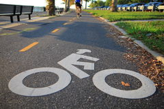 Bicycle lane in the autumn Brooklyn park. Bicycle lane in the autumn park close to the Verrazano-Narrows Bridge , The largest and longest bridge in New York City stock photography