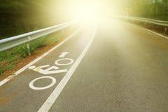 Bicycle lane  with beautiful sun ray. Royalty Free Stock Image