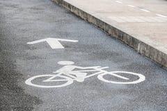 Bicycle lane. Bicycle logo on bicycle lane in the park Royalty Free Stock Photos