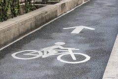 Bicycle lane. Bicycle logo on bicycle lane in the park Royalty Free Stock Image