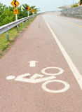 Bicycle lane bicycle path and coastal road Royalty Free Stock Images