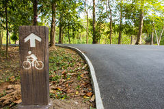 Bicycle lane with bicycle sign. Bicycle lane in the park Royalty Free Stock Photo