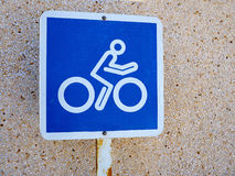 Bicycle lane blue and white sign Stock Photography