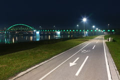 Bicycle lane and bridge at night Royalty Free Stock Photos