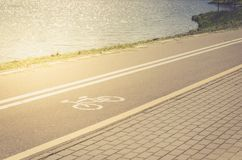 Bicycle lane for exercise surround with along lake/bicycle lane for exercise surround with along lake in sunrise royalty free stock photo