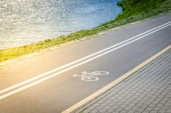 Bicycle lane for exercise surround with along reservoir/bicycle lane for exercise surround with along reservoir in sunrise royalty free stock photo