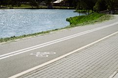 Bicycle lane for exercise surround with along reservoir/bicycle stock images
