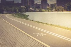 bicycle lane for exercise surround with along reservoir/bicycle lane for exercise surround with along reservoir. Toned stock image