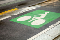 Bicycle lane. Green road marking on road Royalty Free Stock Photo