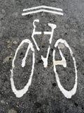 Bicycle lane mark. On street Royalty Free Stock Image