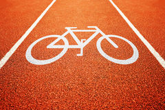Bicycle lane. Mark. White sign for bicycle track in the park Royalty Free Stock Image