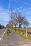 Bicycle lane next to the street in autumnal landscape Stock Images