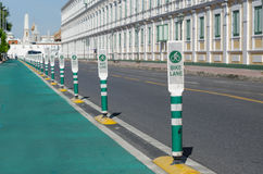 Bicycle lane and notice pole in the city. Royalty Free Stock Photography