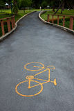 Bicycle lane in park. Bicycle symbol in the middle park of Thailand Royalty Free Stock Photos