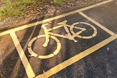 Bicycle lane in the park. A bike lane for cyclist. Bicycle lane in the park Stock Photos