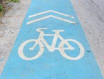 Bicycle lane in park. Bicycle lane - white symbol on blue Royalty Free Stock Image