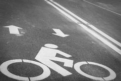 Bicycle lane or path, icon symbol on asphalt road Royalty Free Stock Image