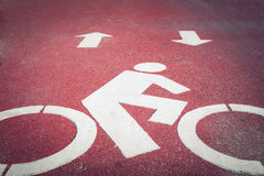 Bicycle lane or path, icon symbol on asphalt road Stock Photos