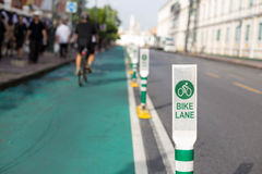 Bicycle lane pole sign on the street Stock Images
