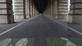 Bicycle lane on Pont de Bercy, famous bridge over Seine river, travel to France. Stock footage stock video footage