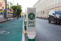 Bicycle lane beside road in the city. Bicycle lane beside the road in the city Stock Photography