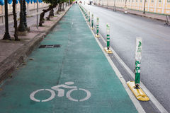 Bicycle lane beside road in the city. Bicycle lane beside the road in the city Stock Photos