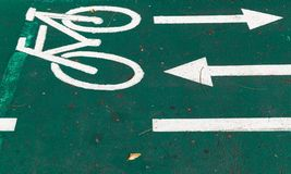 Bicycle lane, road marking with arrows royalty free stock image
