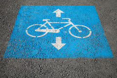 Bicycle lane, road marking over urban asphalt road Royalty Free Stock Images