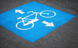 Bicycle lane road marking over urban asphalt road Royalty Free Stock Images