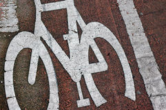 Bicycle lane road markings. A cycle lane road marking, in red and white. From England, UK Royalty Free Stock Photography