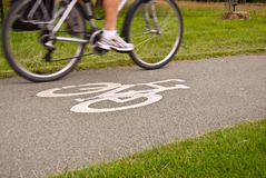Bicycle lane road sign. With the speeding cyclist Stock Image